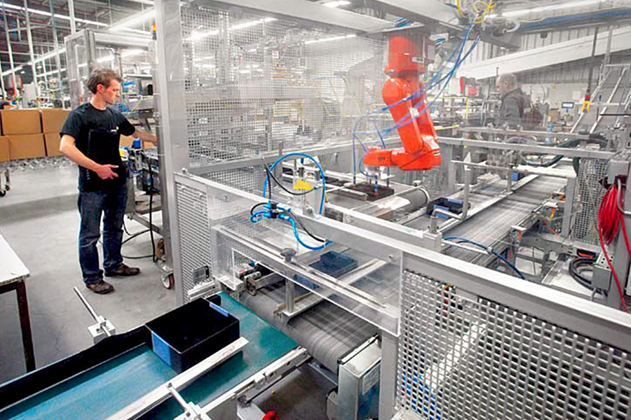 man using robotics to clean food facility